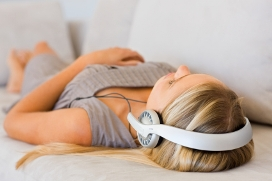 Woman Lying Down Listening to Headphones
